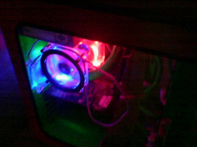 The 1 fan on the side(blue) that blows onto the cpu fan (red)