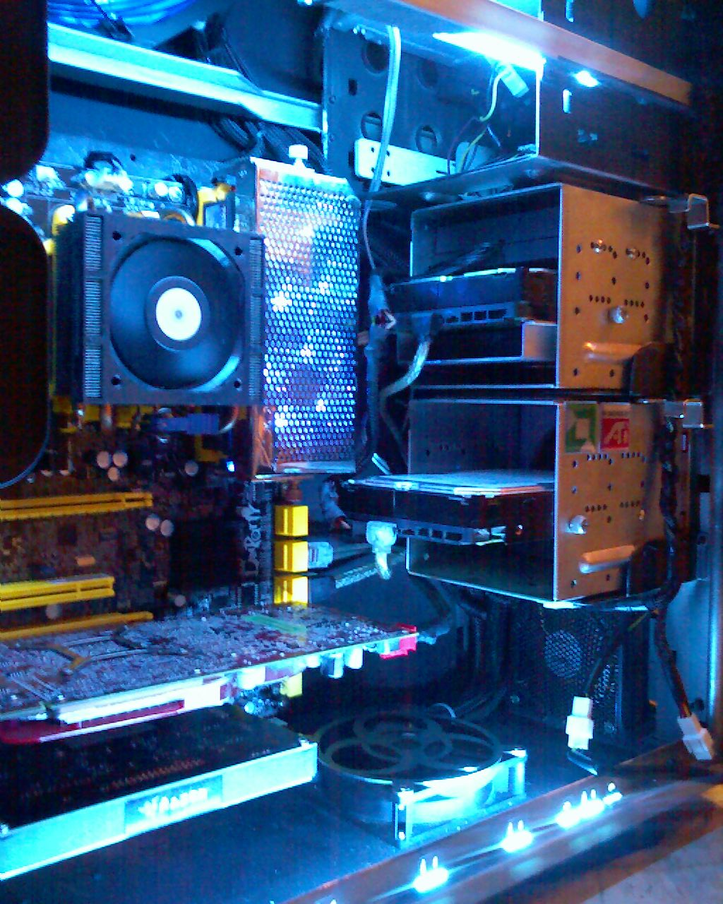 Sorry for the poor picture quality, but I wanted to include pics of the PSU and top exhaust fan