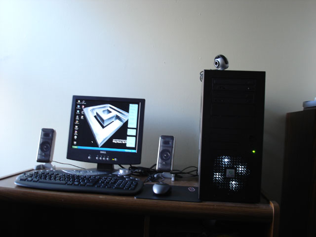 this is my whole setting. i know i know theres a dell lcd. im gonna go kill myself now. btw... sorry i didnt have pics at night of my pc. i havent finished the lighting yet. need a CCFL quick. any good color suggestion fellow pc overclockers? :D
