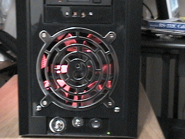 This case had only a small air inlet at the bottom of the front panel, so I had to cut out a hole.  I used a 120mm fan grill to finish it off.  I had to move the power switches and LEDs down to the old USB location.