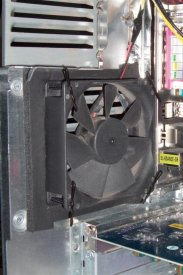 Soft-mounted rear fan