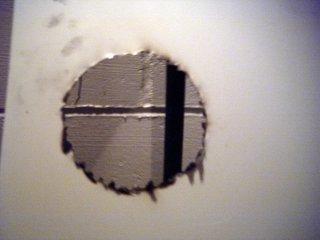 Charred hole
