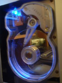 Hard Drive detail - I custom made the cut with a dremel and put a plexiglas panel. Also installed a blue led.
